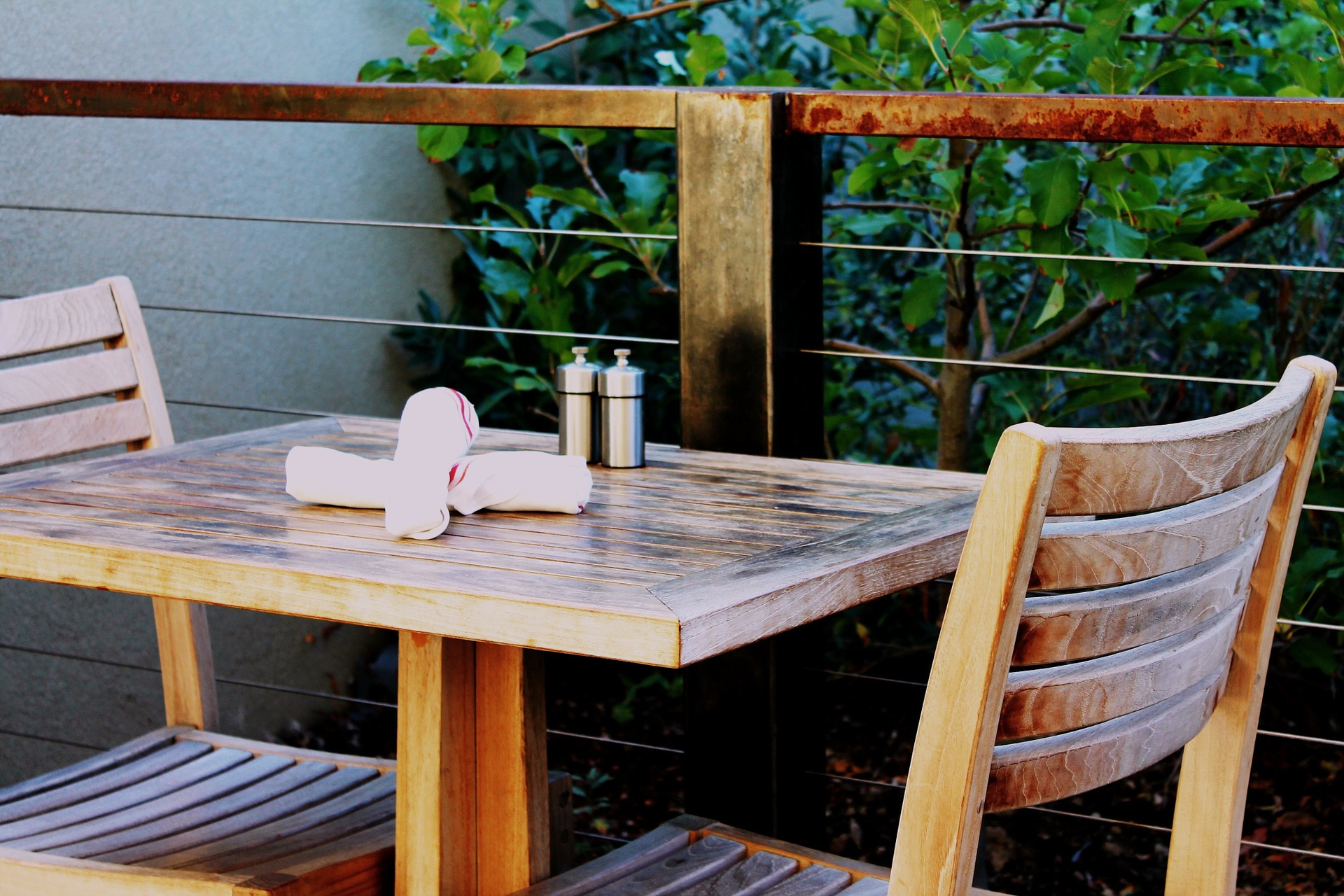 Two napkins on Wooden table with chairs
