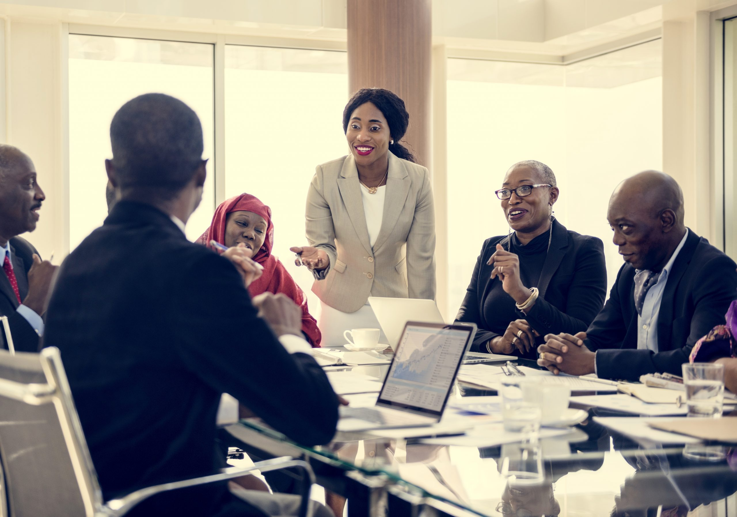 Black men and women having a meeting at a conference room.