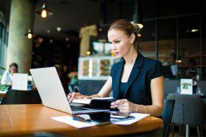 Female entrepreneur checking online e-mail via netbook