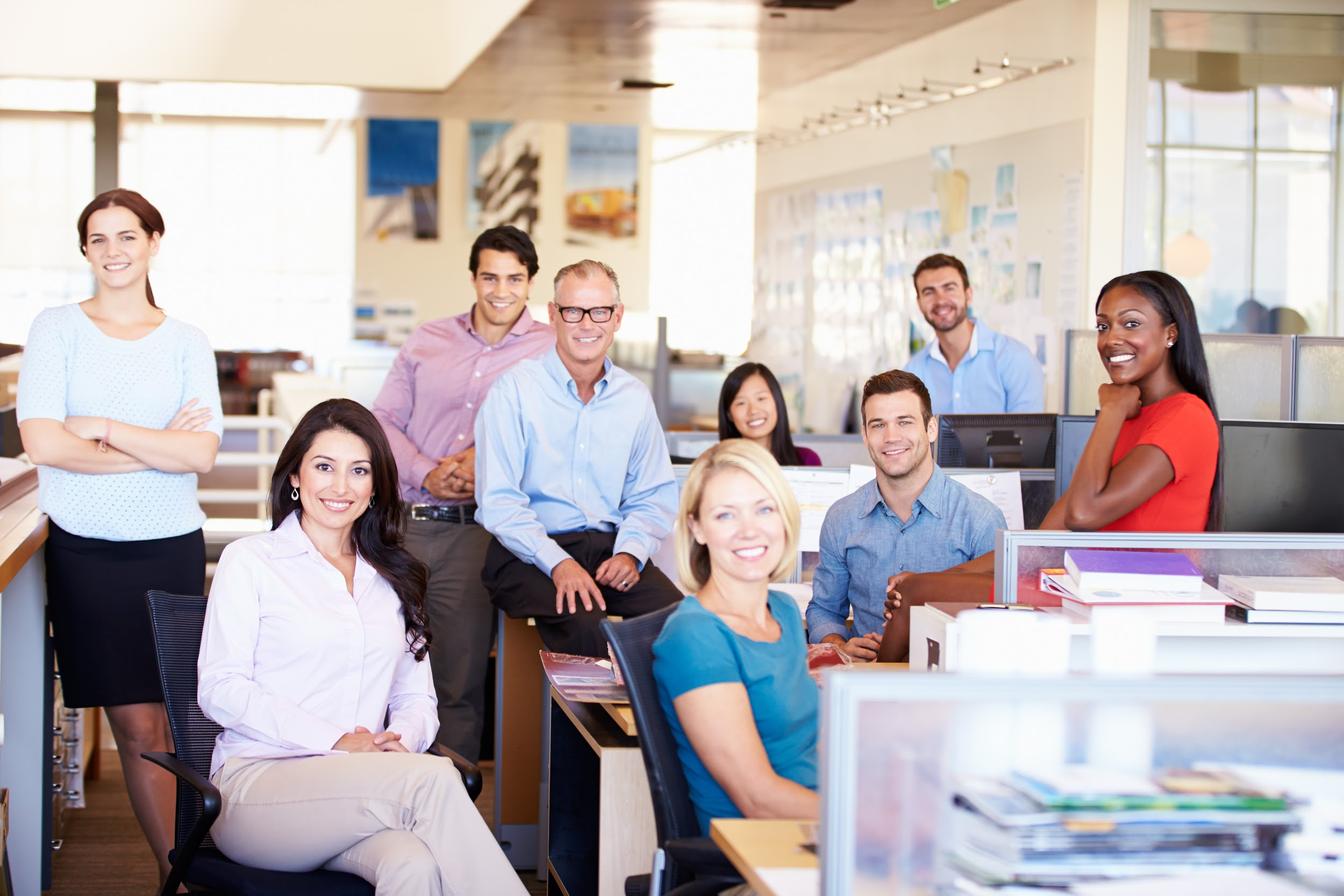 smiling professional men and women in the office