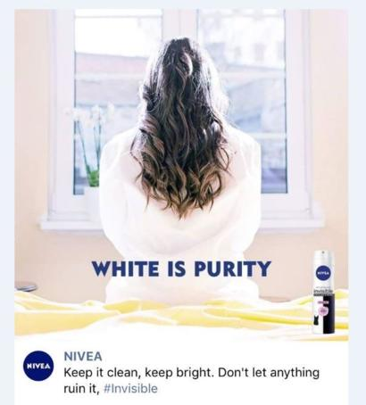 'White is Purity' ad of Nivea showing the back of a long-haired woman in white clothes.
