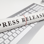 Press Release news paper on the top of the keyboard