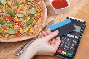 credit card ready for swipe to pay a bill