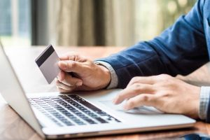 man checking credit card online