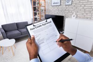 guy signing Real Estate Appraisal Form