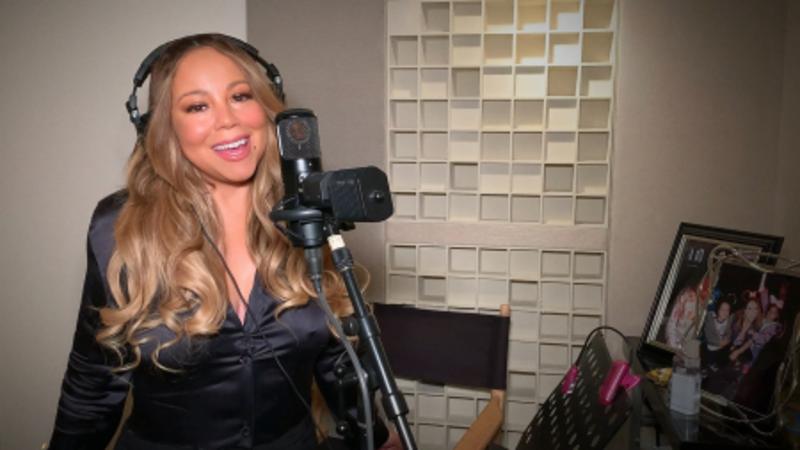 Mariah Carey singing in her studio at home.