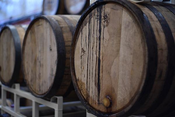 three barrel of distilled liquid