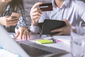 man and woman checking credit card