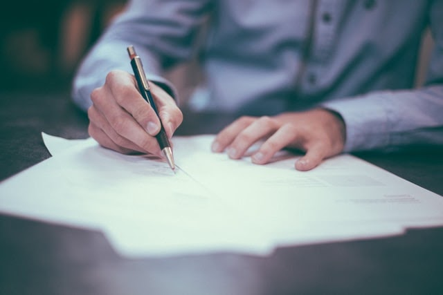 a man signing a letter of intent