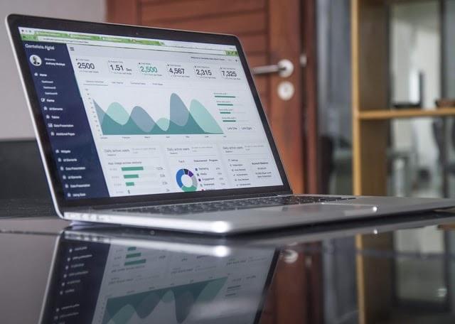 restaurant's key performance metrics on laptop