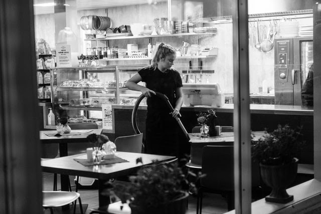 woman cleaning the restaurant