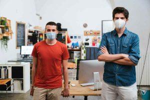 two men wearing facemask