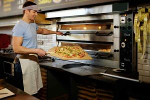 man making pizza