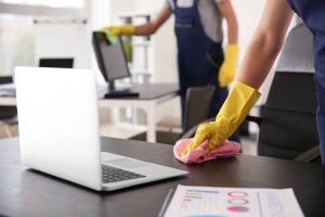 a laptop and a cleaner