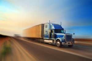 American truck speeding on freeway at sunset, motion blurred