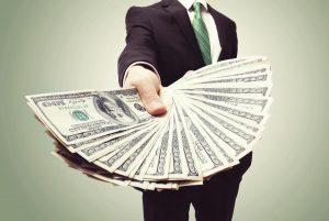 man holding lots of money