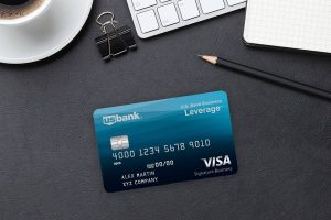 us bank credit card with pencil coffee notebook and clip