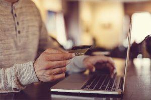 Man Inputting credit card details