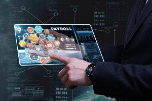 hand using a digital payroll interface