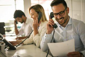 employee using landline phone