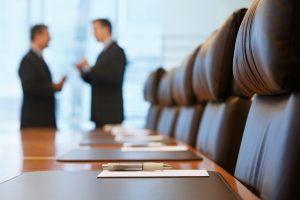 Businessmen in Conference Room