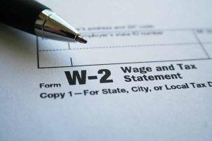 W-2 Form with pen