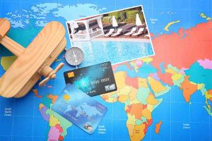 Credit cards on world map background