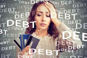 lady in debt holding a credit card