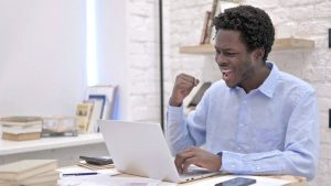 happy guy working in laptop
