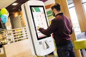 Man using a self-service kiosk