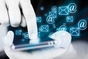 email icon and symbol, hand touching phone screen
