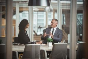 businessman and woman talking something relevant about business
