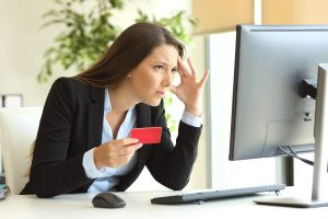 woman having trouble with her credit card