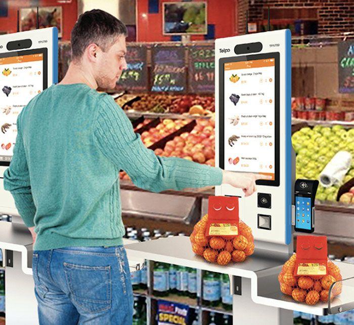 Man Using Self-Checkout Kiosks