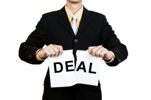 Person Tearing Paper that written Deal into it