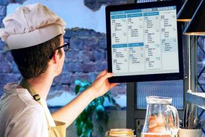 chef checking the kitchen display system