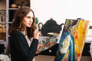 woman artist staring at her painting