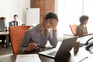 Working woman feel stressed, tired from work