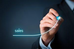 Businessman writing arrow graph