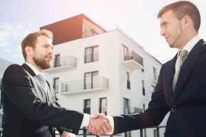 2 businessman shake for successful deal