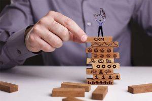 man on top of CRM blocks