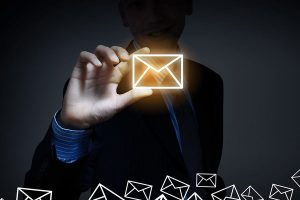 man holding a mail icon