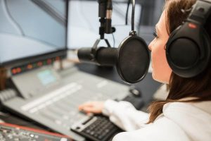 dj works in broadcast studio