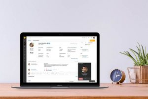 CRM's contact management on laptop screen