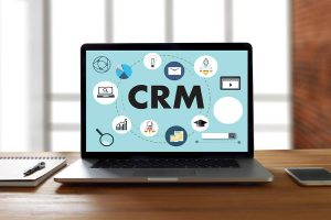 CRM text surrounded by web icons