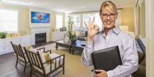 a female in the office doing OK sign