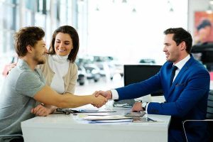 salesman and customer handshake after successful deal