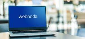 Laptop displaying logo of Webnode
