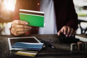 man holding creditc cards