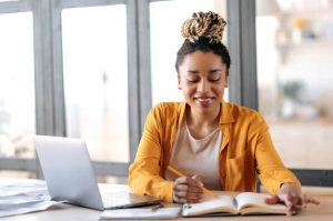 woman happily studying